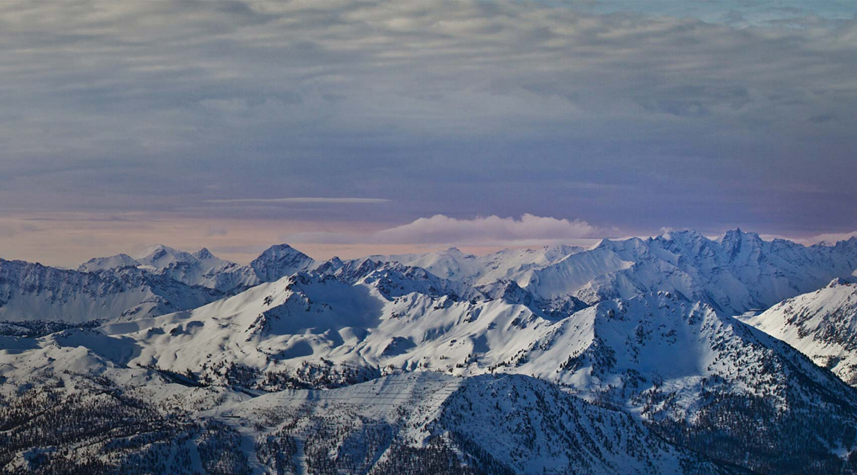 View of the mountains in the winter. Ski resort Sauze d'Oulx with lots of apartments ski holiday