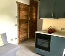 Living, kitchen room modern luxury and comfort in Chalet style Casa della Figlia, ski holiday apartment central Sauze d'Oulx